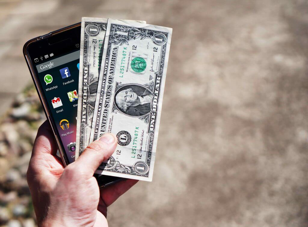 Image of a mobile phone with money.