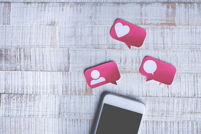 Smart Phone with Paper Cut Social Media Icons in Speech Bubble